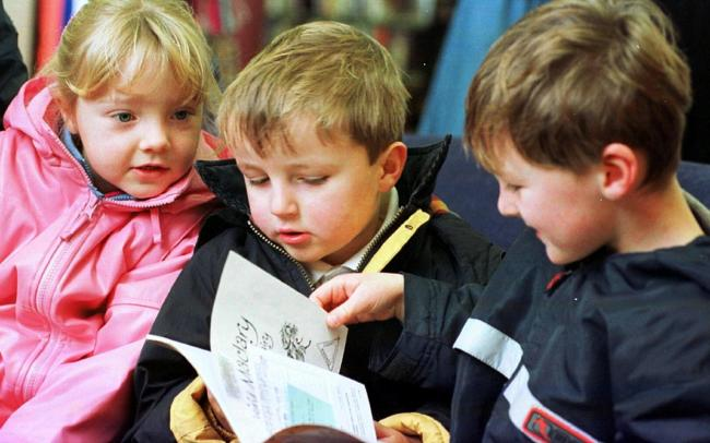 LEARNING Youngsters from Thwaites Primary School mark National Book Week at Millom library in November 2000.