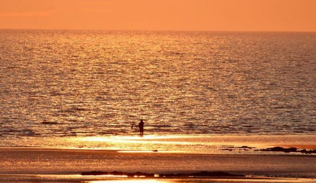 COAST: Casting into a sea of gold at Walney beach by The Mail Camera Club member Thomas Pearce