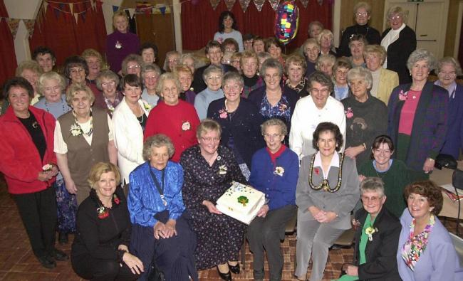 PARTY Members of the Rampside branch of the Women's Institute celebrating their 80th anniversary in November 2000.