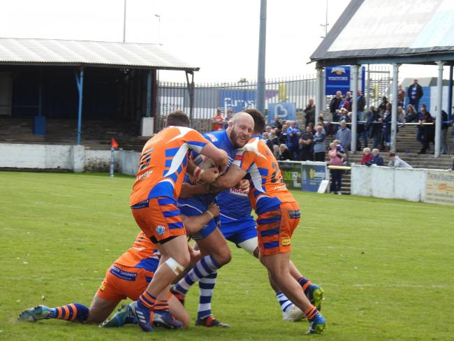 POWERING ON: Halifax struggle to bring Barrow Raiders forward Danny Morrow to the ground
