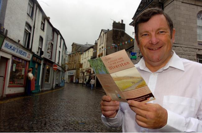 TREK  Peter Winston from Ulverston Marketing Forum with a brochure promoting a new 11-mile walk in September 2005.