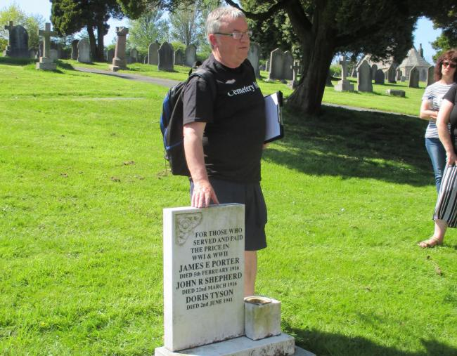 DISCOVERY Rod white at the grave of Doris Tyson during a guided walk of Ulverston cemetery.