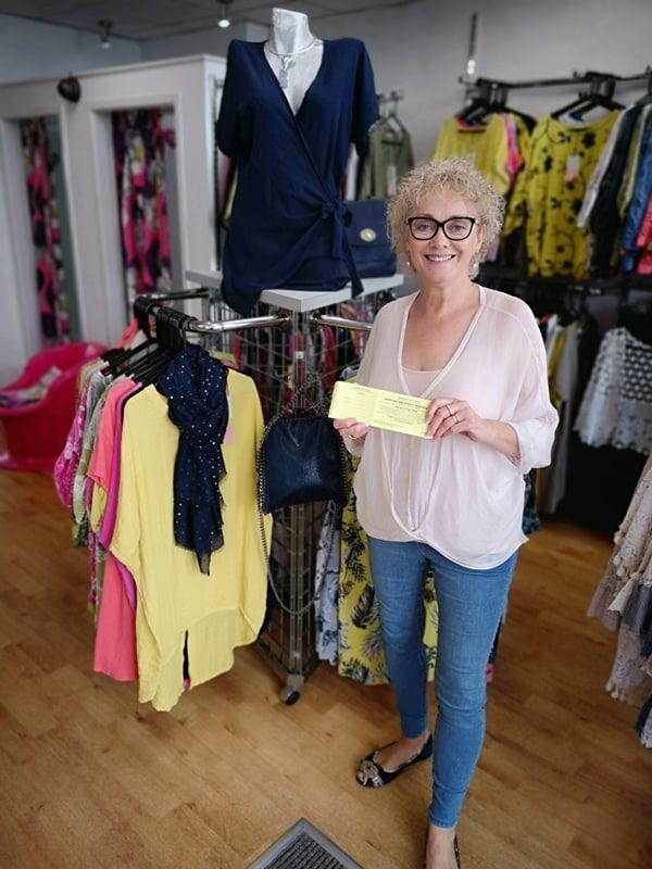 FUNDRAISING: Pretty Things Boutique have been working with Barrow Golf Club ladies' captain Barbara Foster to support St Mary's Hospice.
