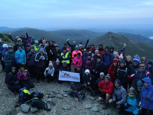 SUMMIT: In celebration of St Mary's Hospice 30 year anniversary, dozens of brave walkers took on one of Britain's highest peaks: Helvellyn. The team finished the route at 4am yesterday morning, celebrating with a glass of fizz after reaching the s