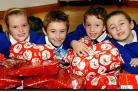 SUPPORT Pupils from  Low Furness School, Urswick, in December 2007 with gifts to be sent to Africa.