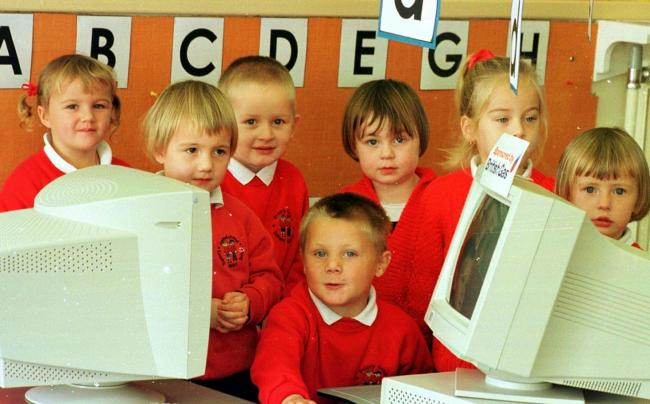 TECHNOLOGY All smiles from pupils at  Barrow's Priory Grove School after getting computers in a British gas scheme.