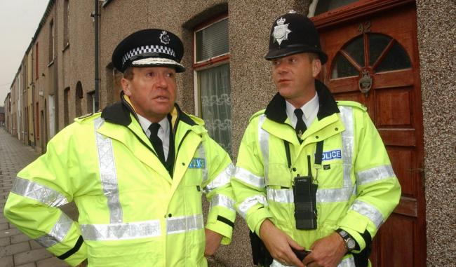 PATROL Cumbria Chief Constable Michael Baxter with PC John Irvine in Arthur Street, Barrow, in May 2003.