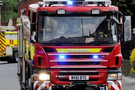 FIRE: Firefighters battle large asbestos roof and barn fire