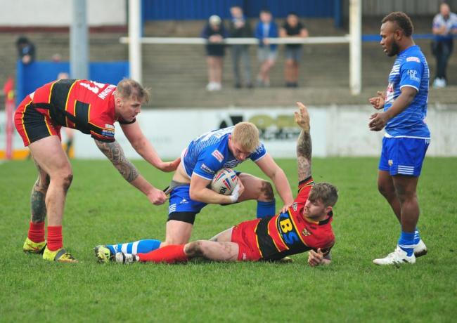 Jake Spedding is tackled during February's drawn match at Craven Park