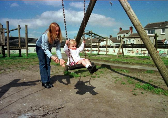 SWINGS Stacy Clark and her daughter Khenya at the Devonshire Road Play area, Millom, in May 2001.