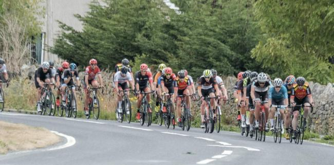 BUNCHED UP: The peloton makes its way down the Coast Road during last year's race