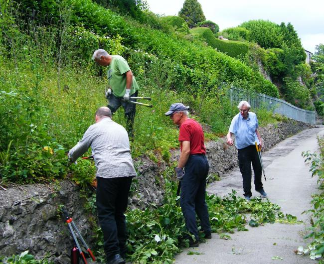 TRIM: Gill Banks Action Group volunteers teamed up with Ulverston in Bloom to trim the overhanging greenery from Cumbria Way.