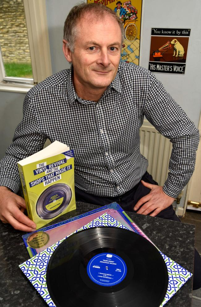 Graham Jones, vinyl record enthusiast and author with his second book 'The Vinyl Revival and the Shops that made it Happen'  at home in Chippenham. Photo by www.gphillipsphotography.com GP1460