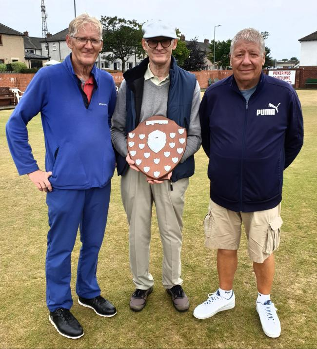 Salthouse Over 60s Open Pairs winners Colin Taylor and Billy Thompson with Salthouse chairman John Taylor