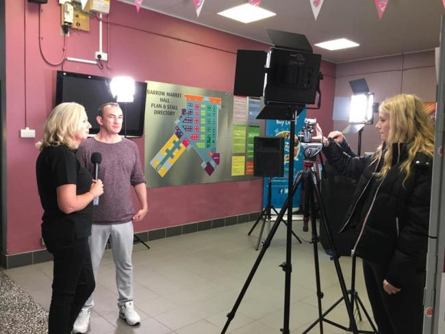 "VISITOR: Barrow Market Hall had a special visit from former Bay Radio and Heart FM DJ, Danny Matthews for their Feel Good Friday event. Jacqui Armstrong admin assistant at Barrow Market said: ""Danny was a great hit with our customers and many of his"