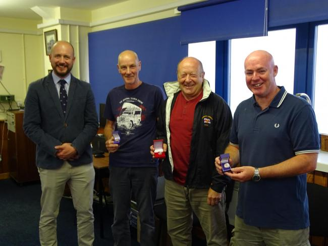 AWARDS: (l-r) Saul Mendelssohn, RNLI area lifesaving manager Alan Cleasby, Alec Moore and Dave Johnson
