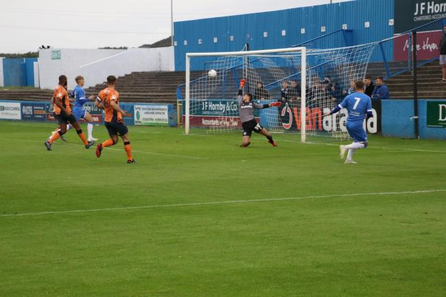TOP CORNER: Jack Hindle smashes in the opener against Oldham Athletic in the Lancashire Senior Cup