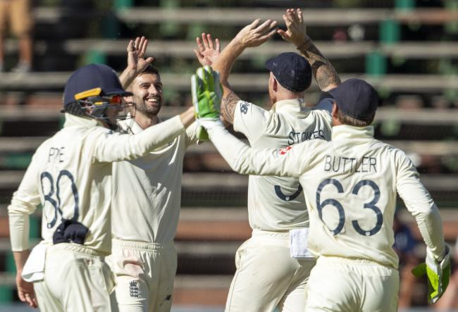 IN THE WICKETS: Mark Wood (second from left) celebrates after dismissing South Africa's Quinton de Kock