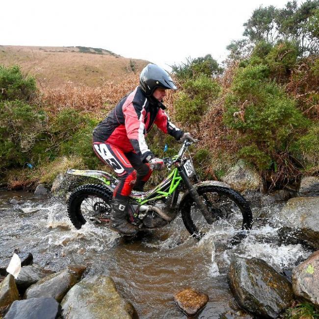 Ulverston`s  Angus Jenkinson tackles a rocky stream on his way to taking the honours on the Clubmans course