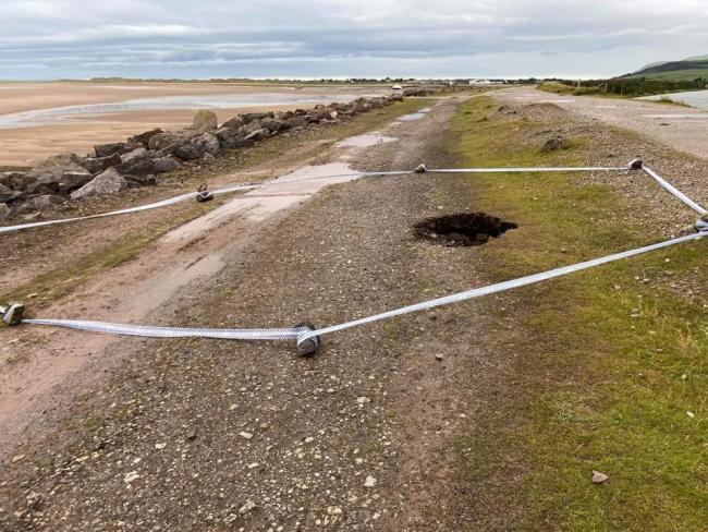 TAPED OFF: A large sinkhole has been discovered on the sea wall in Millom