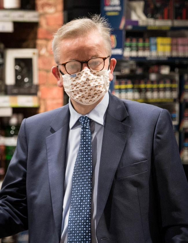 Chancellor of the Duchy of Lancaster Michael Gove buys a cigarette lighter from a shop near St James's Park in Westminster, London. Wearing face masks in shops will become mandatory from July 24, and Health Secretrary Matt Hancock has denied their is