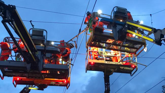 IMPROVEMENTS: Work being carried out on overhead cables