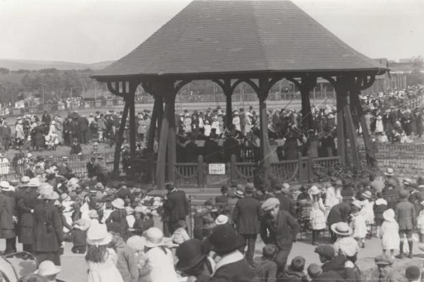 A lively scene at the old bandstand in Barrow Park during the 1930s