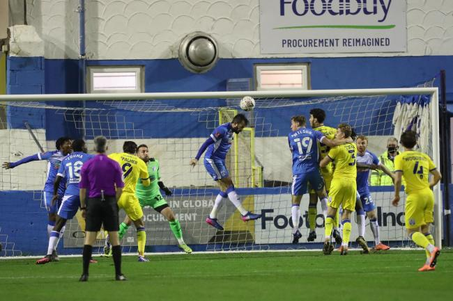 Clearance: Barrow keep Wimbledon at bay in their agonising FA Cup defeat (photo: Mark Fletcher | MI News)