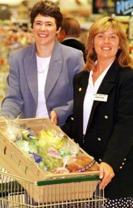 The Mail: GIVING: Barrow Age Concern chief officer Adrienne Poole (left) is pictured with Asda Store deputy Christine Graft