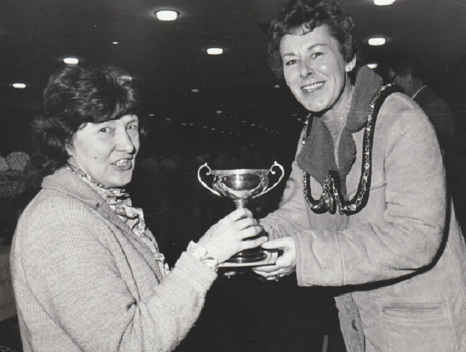 PRESENTING: The Mayoress presents the T Kenworthy Memorial Challenge cup to Mrs D Dawes at Barrow Chrysanthemum Society show in 1987