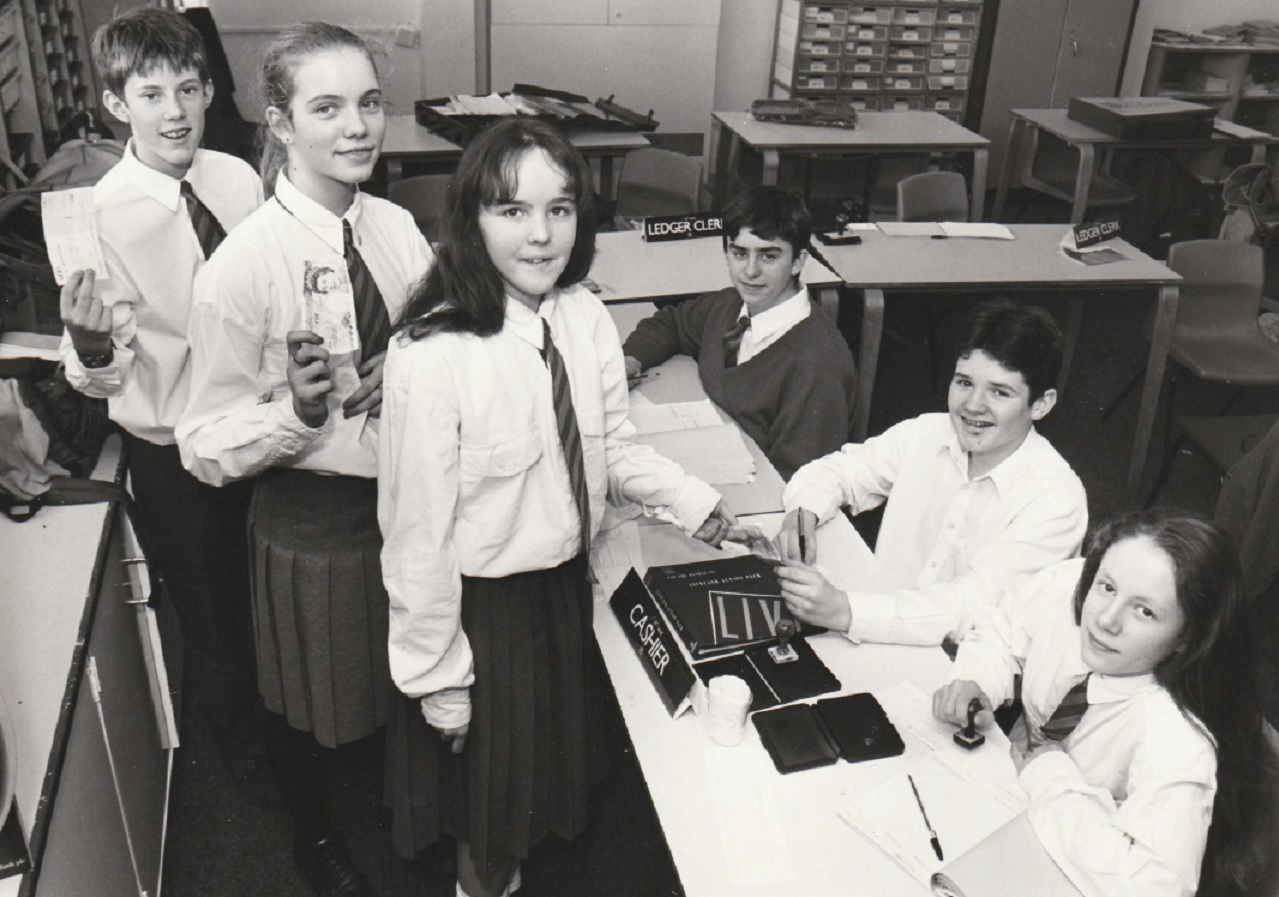 BANK: Customers Ben Silcocks, 13, Belinda Vause, 13, and Carly Walters, 14, queue to bank their cash to Keir Arts, 14, Chris Johnson, 13, and Joanne Rogan, 13, at Thorncliffe School's Mid-Bank in 1994
