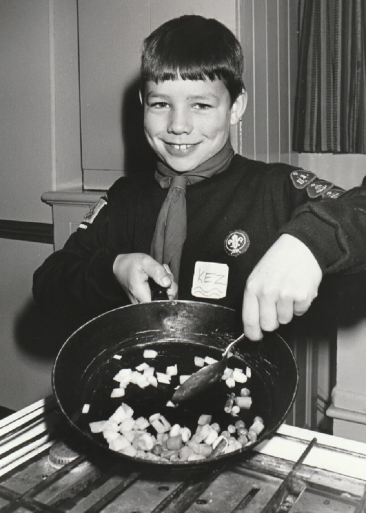 SMILES: Kerry Morrow, nine, cooks up a tasty meal at the Sixers Training Day for Duddon and High Furness Cub Scouts in 1995