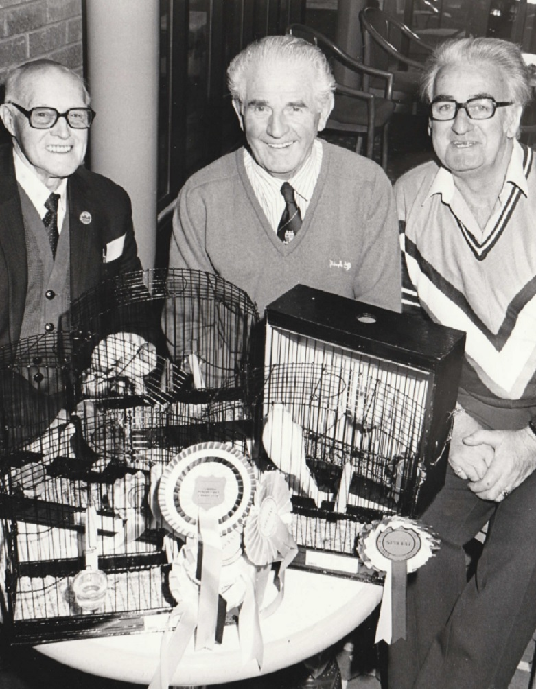 BIRD: From left: Cecil Newby, of Ulverston, Alec Dancer, of Barrow and Alan Edwards, of Ulverston, with their border canaries and Norwich canary