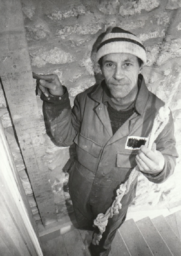 THE NAMES RING A BELL... Jim Boulton in January 1998 with a piece of wood from the bell tower containing names of bellringers from bygone days