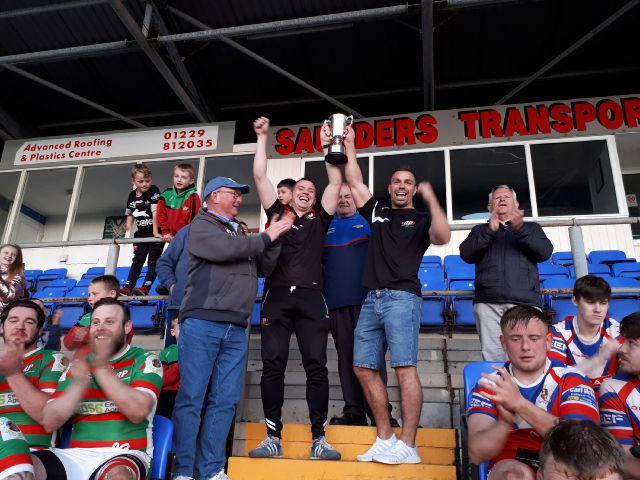 Roose rule: Roose Pioneers celebrate their Frank Reid Trophy final victory over Walney submitted