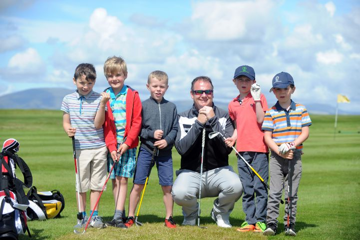 Young players: Barrow Golf Club professional Paul Rawlinson with juniors at the course LEANNE BOLGER