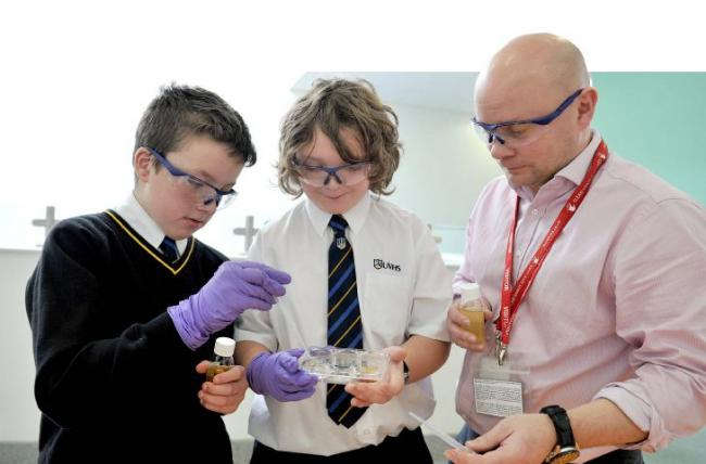 Experiment: William Henderson and Sam Parsons from Ulverston Victoria High School learn about anti doping testing with microbiologist David Keen from GSK Ulverston in 2016 LINDSEY DICKINGS