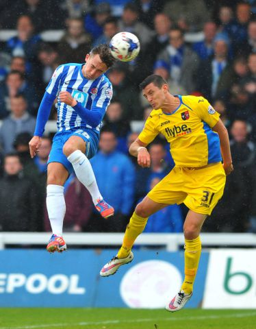 On board: New Barrow AFC signing Dan Jones (left) in action for Hartlepool against against Exeter City FRANK REID