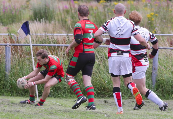 Treble: Alex Brown got three tries for Roose Pioneers against Ulverston A MILTON HAWORTH.
