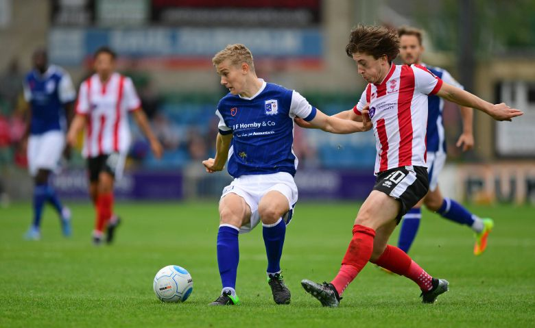 LOAN EXTENDED Barrow's Ryan Yates (left) shields the ball from Lincoln City's Alex Woodyard on Saturday CHRIS VAUGHAN/CHRIS VAUGHAN PHOTOGRAPHY