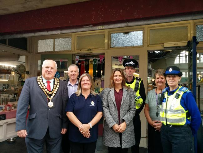 SPECIAL THANKS: Members of Ulverston Community Enterprises with the town's mayor Dave Webster and members of the Ulverston Neighbourhood Policing Team at he opening of Ulverston's new police station.