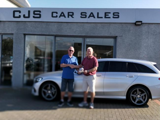 Jeff Coward of the Barrow and District Rugby League being presented with a £250 cheque from Jimmy Salisbury of CJS Cars