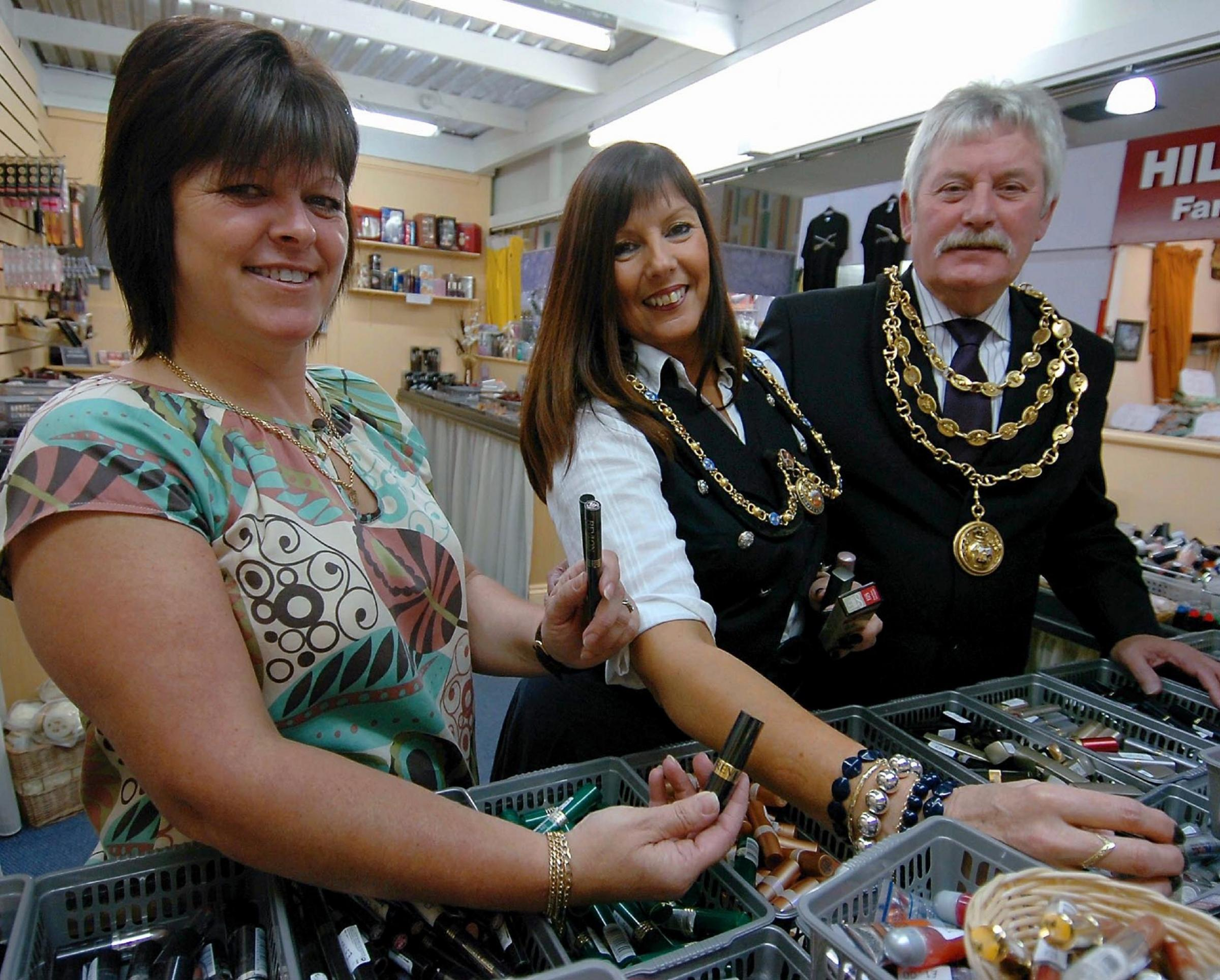 New: Market trader Beverley Benson at her  Barrow Lips and Lashes stall in 2008 with Dave Roberts and Pauline Coates