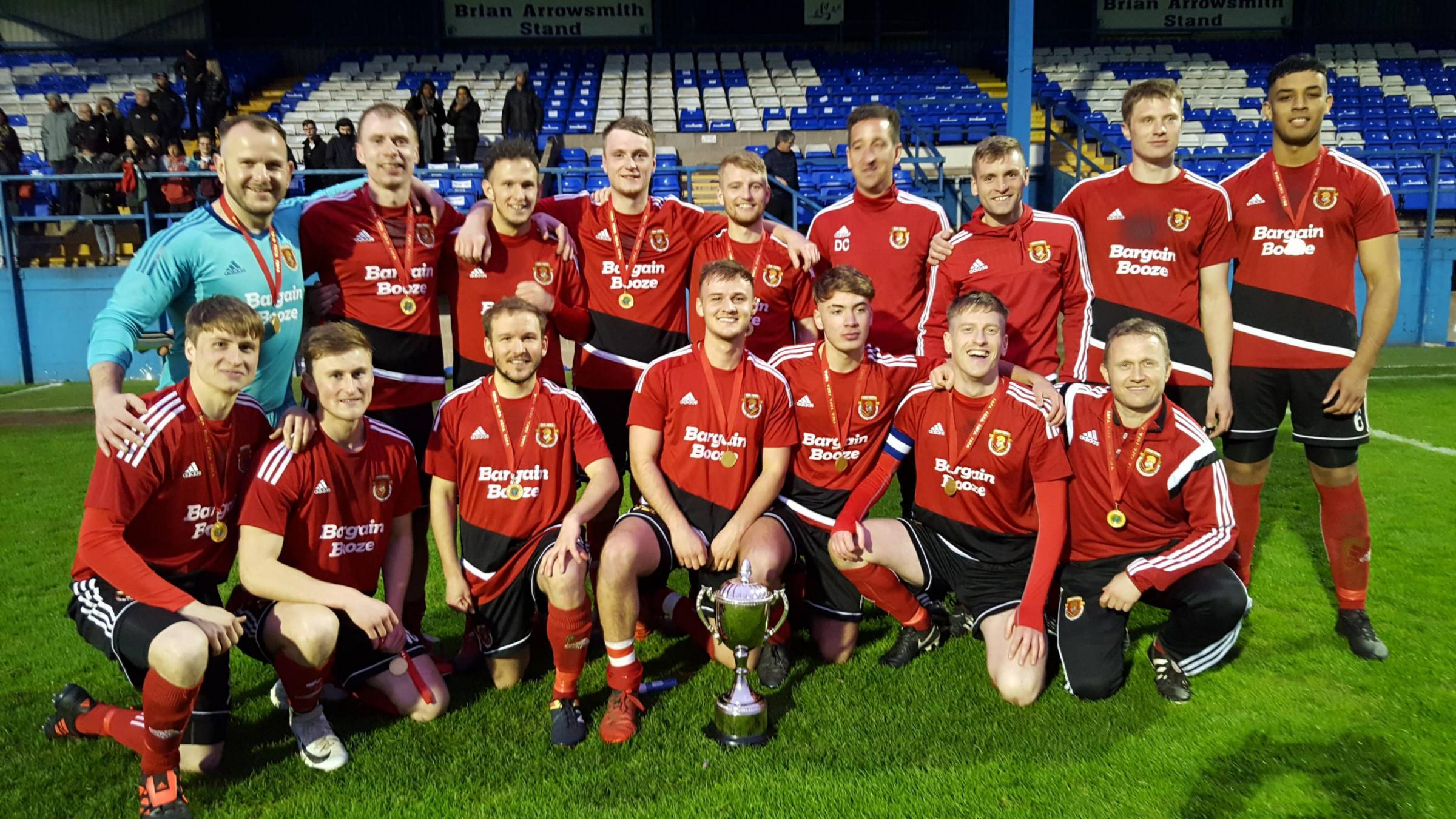 HOLDER: Millom with the Senior Cup