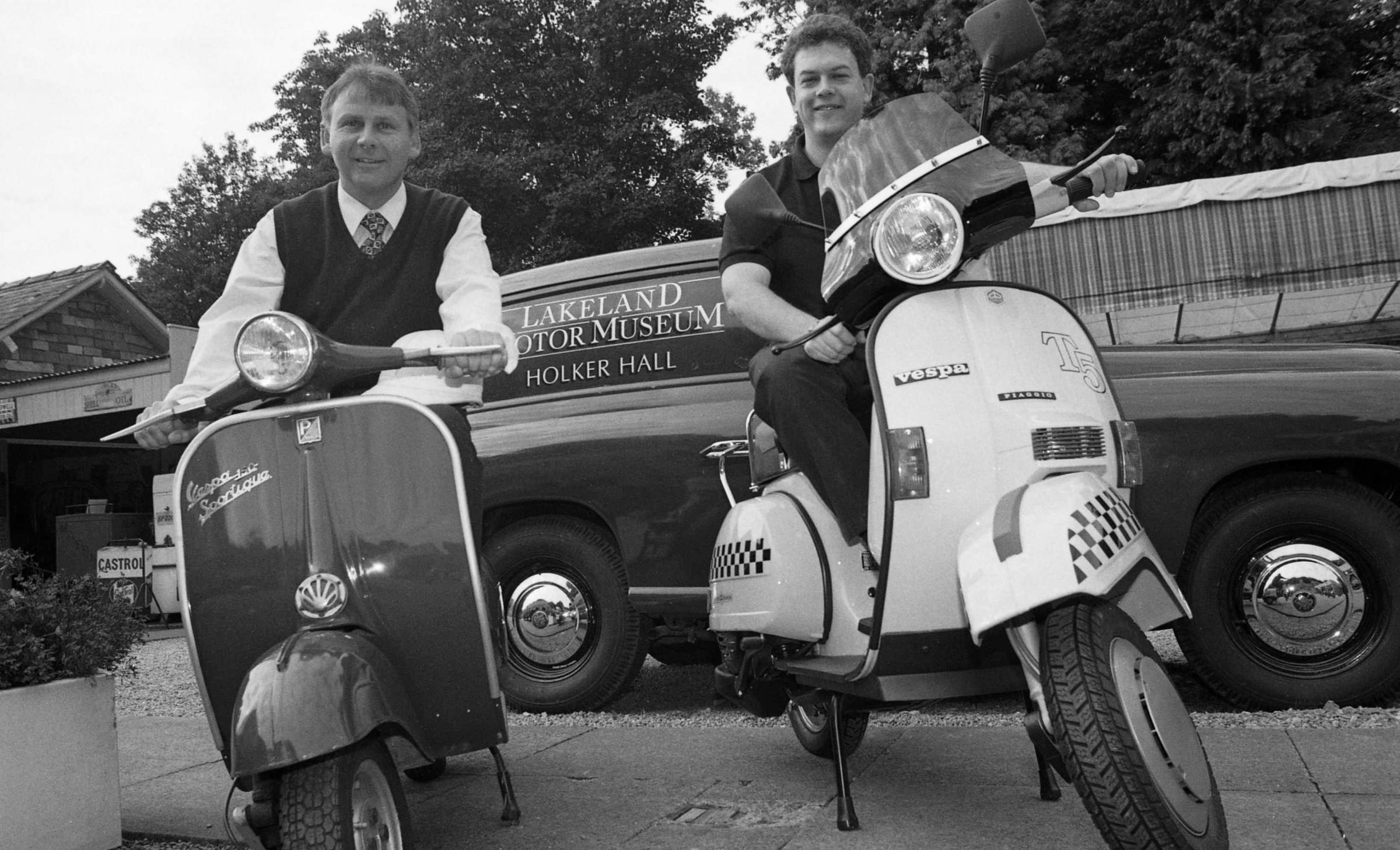 Birthday: Edwin Maher, left, and Martin Crooks, of Barrow's Crooks Suzuki, comparing Vespas in 1996
