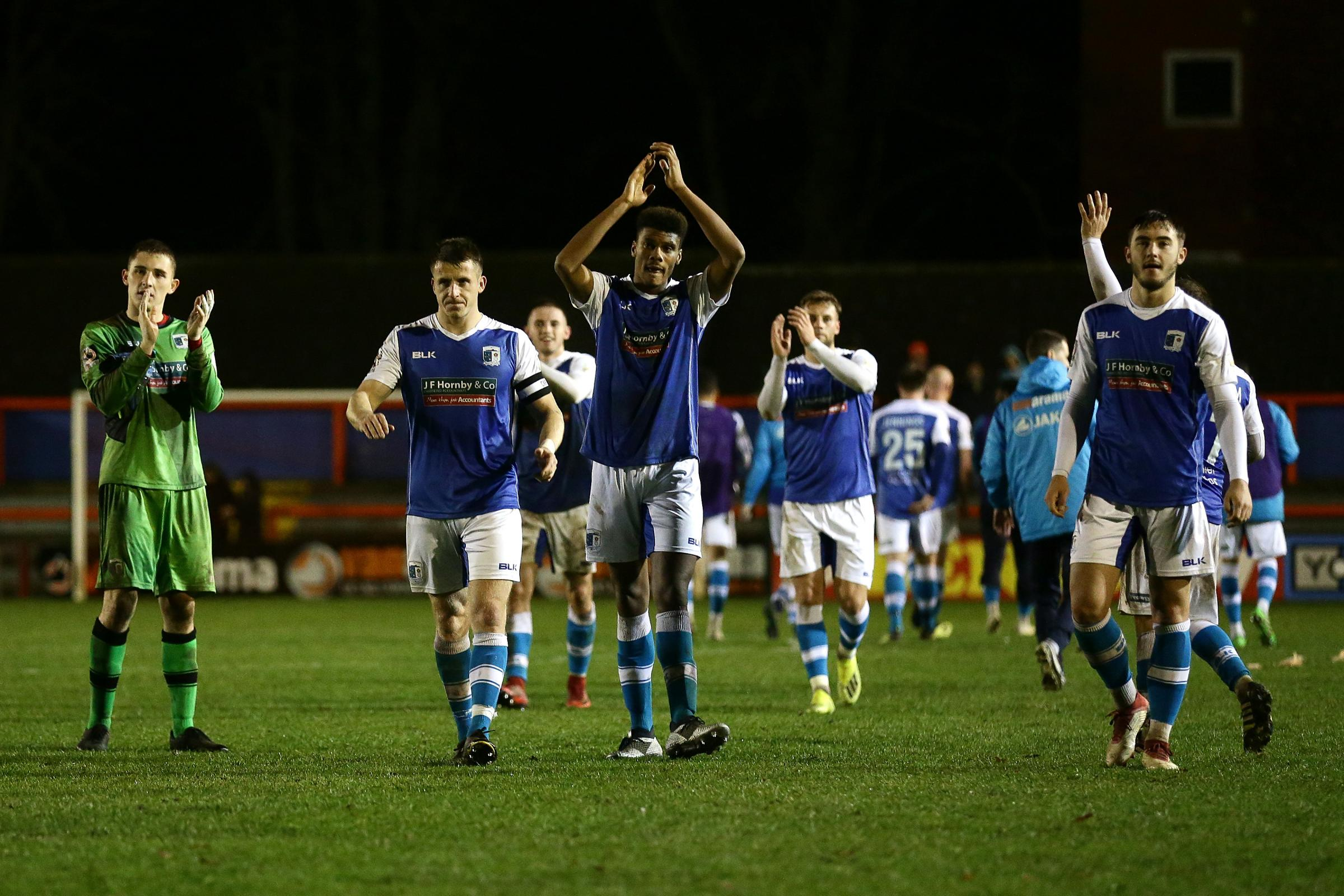Barrow AFC's players go to thank their supporters after their victory at Braintree Town