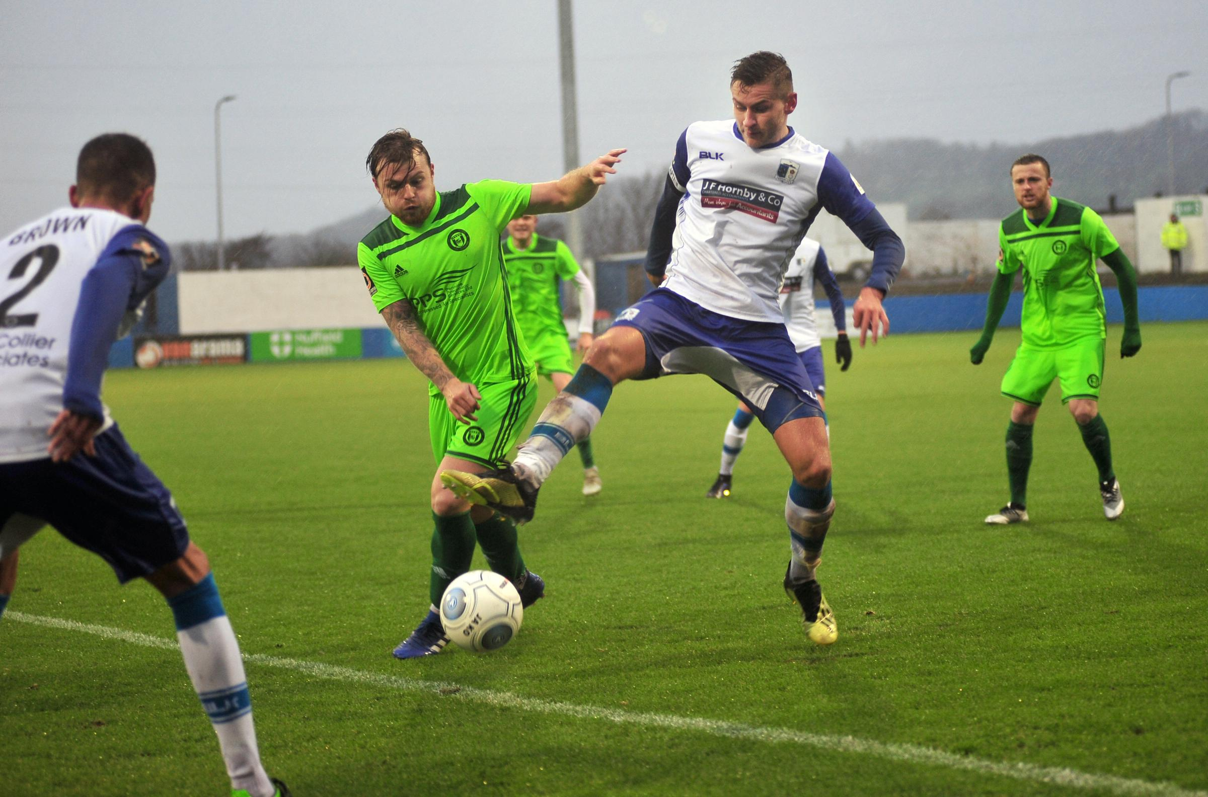 Jacob Blyth battles to keep possession for Barrow AFC