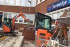 The digger going into the Travelodge