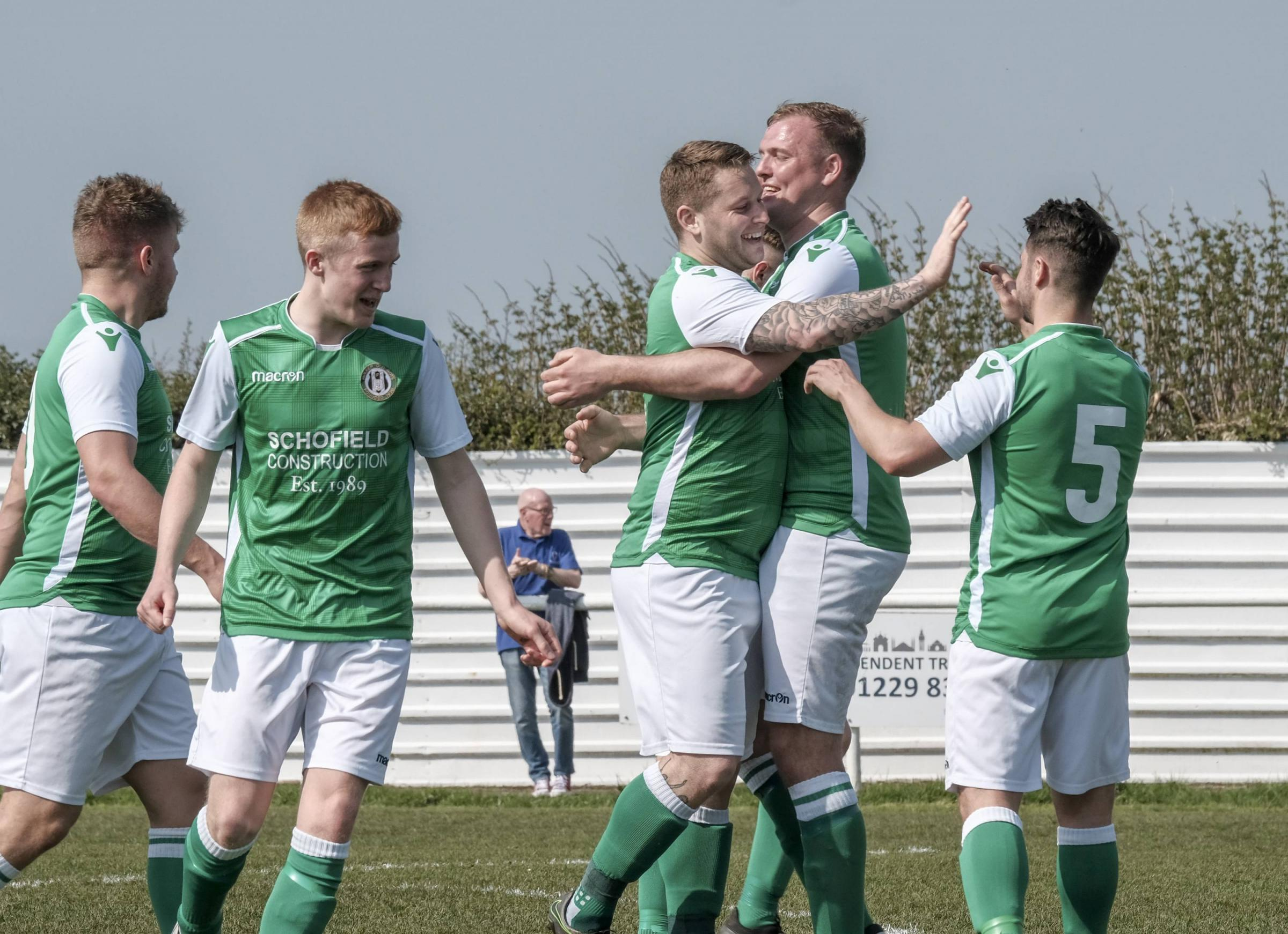 Holker Old Boys celebrate Phil Coombe's goal Picture: Milton Haworth