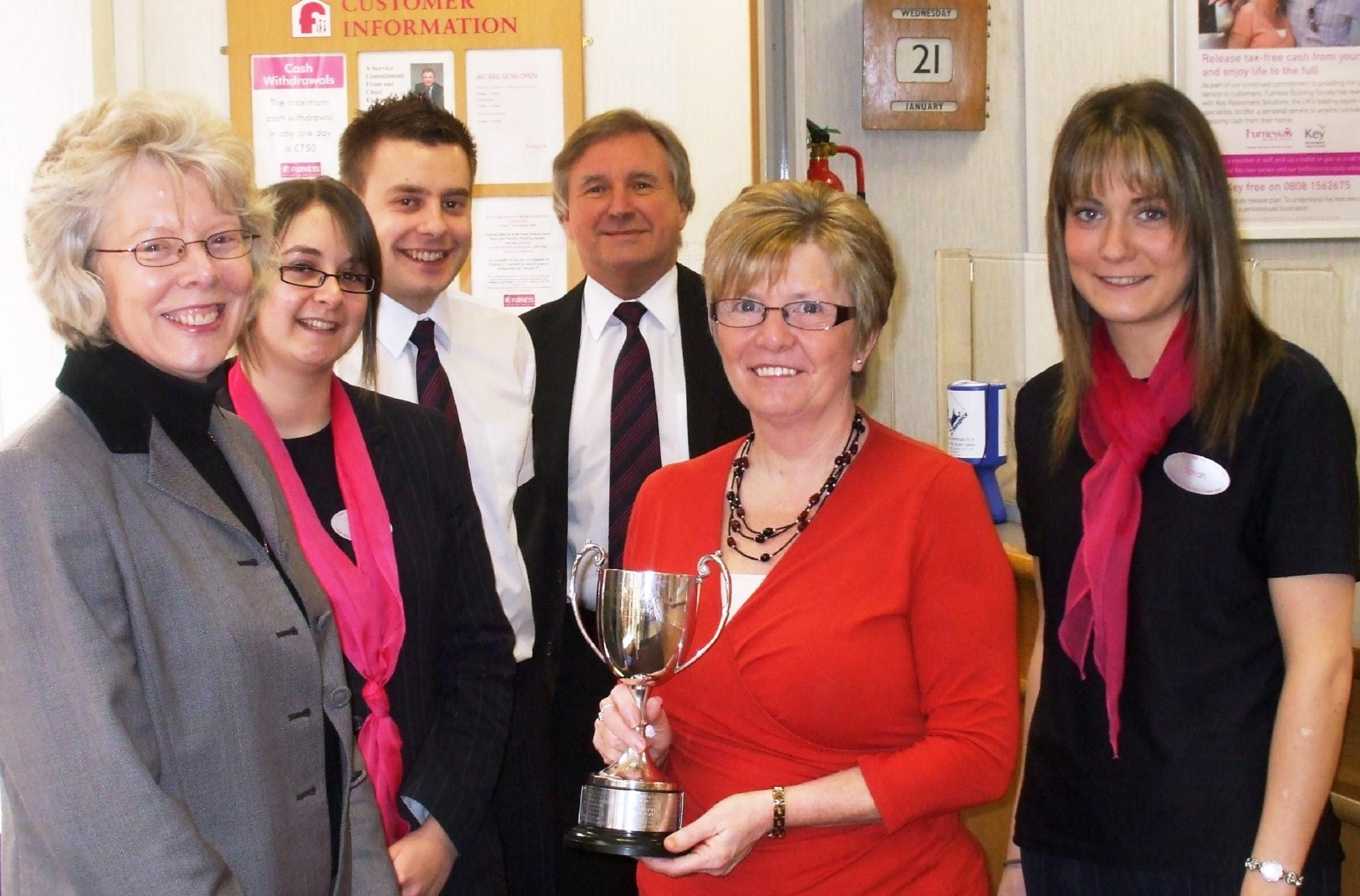 Success: Mary Phipps-Jones in 2009 with the Furness Building Society branch of the year trophy which went to Ulverston